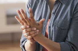 Older-Black-woman-rubbing-her-hands--Arthritis.jpg